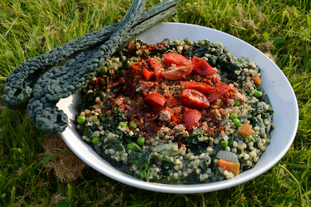Supergreen buckwheat risotto with kale and spinach and peas
