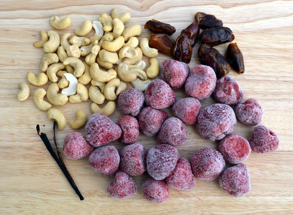Instant Strawberry Cashew Ice Cream ingredients include cashews, dates, vanilla and frozen berries