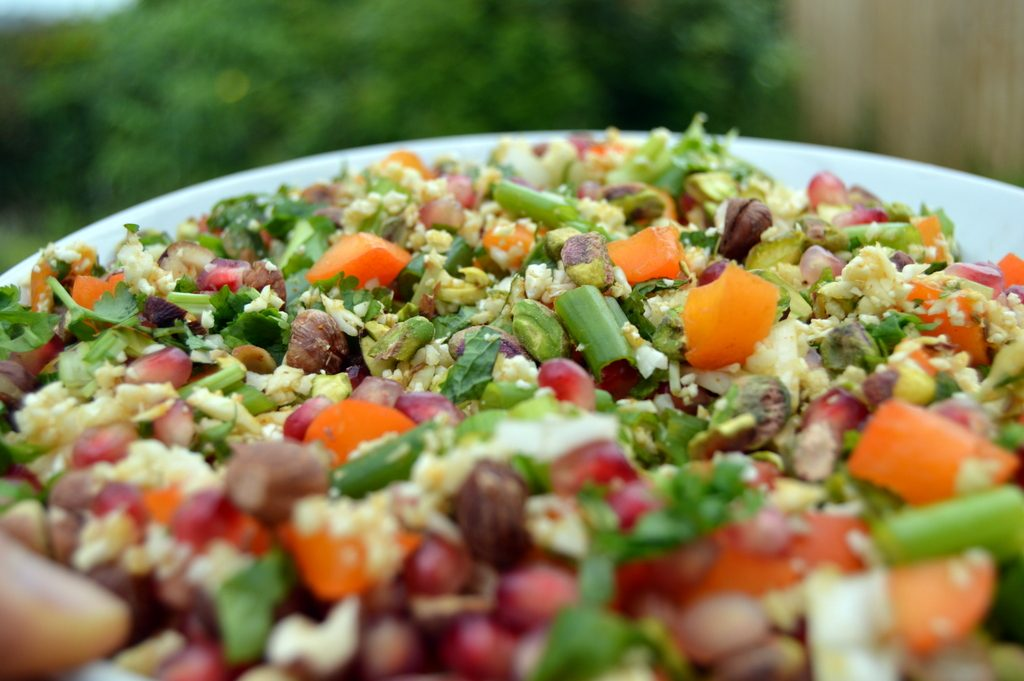 cauliflower cous cous crunch close up full of fruit and nuts. A healthy couscous salad that's perfect for summer meals outside.