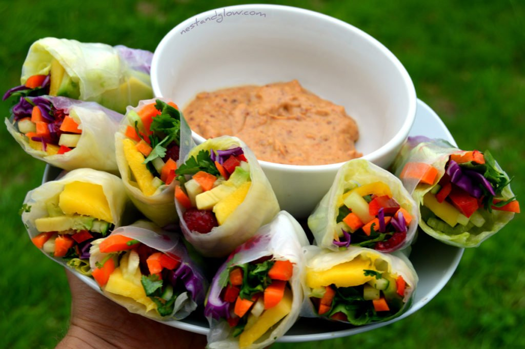 Summer Rolls Healthy Recipe with Spicy Lemon Nut Dips on a plate. These rolls are a great way to load up on healthy fruit and veg.