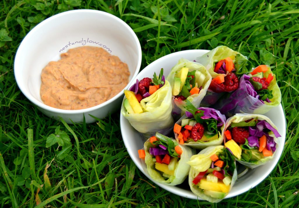 Rainbow summer rolls with a spicy lemon dip make the perfect side dish in warm weather. A nut dip sauce adds protein and healthy fats.