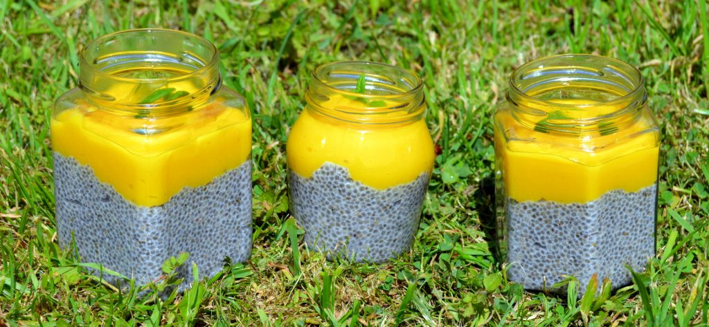 Mango Lime Chia Puddings in a row made from plant based milk and fresh fruit. A healthy chia pudding recipe that can be made quickly