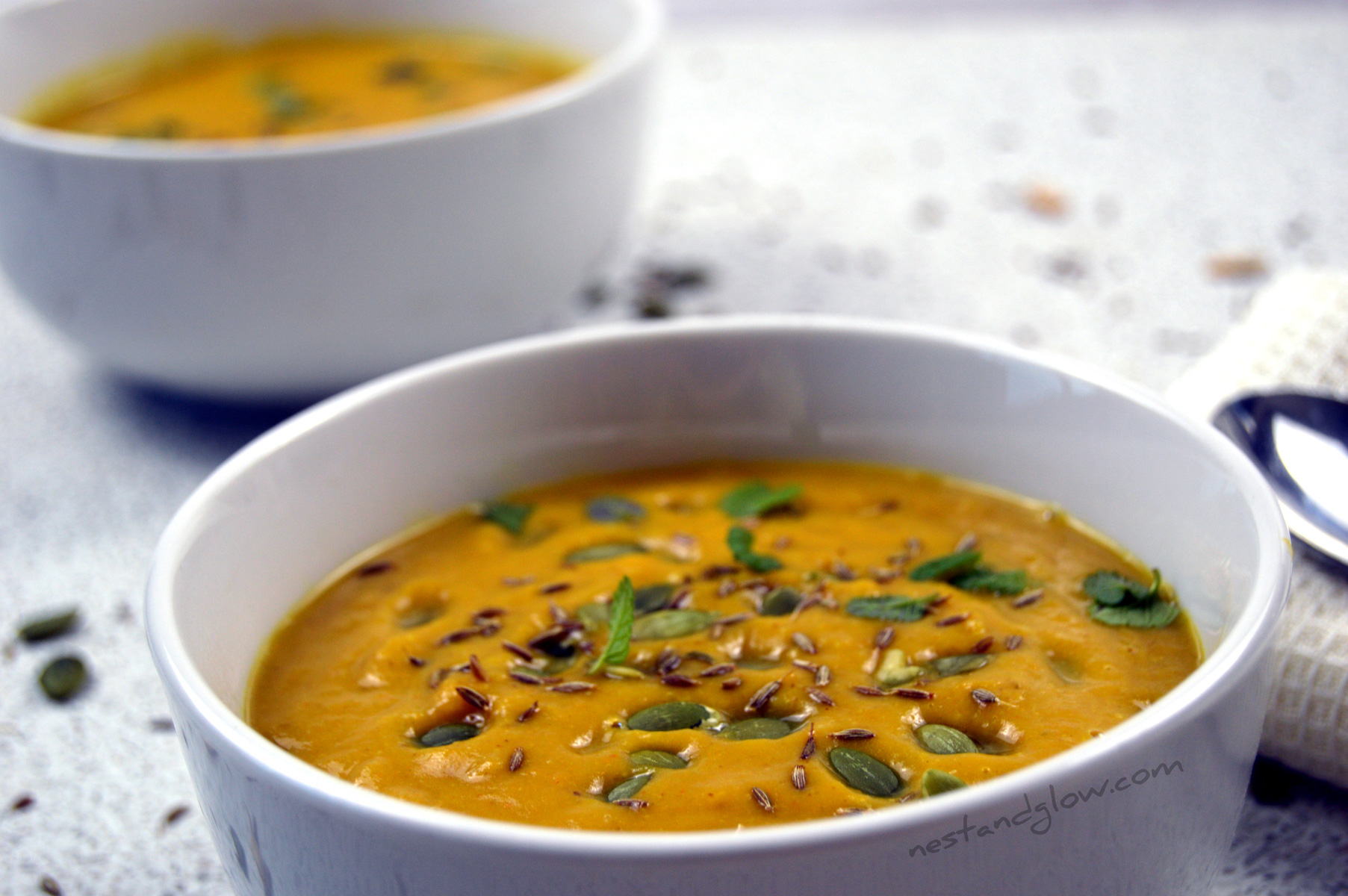 bowl of roasted butternut squash soup with almond butter