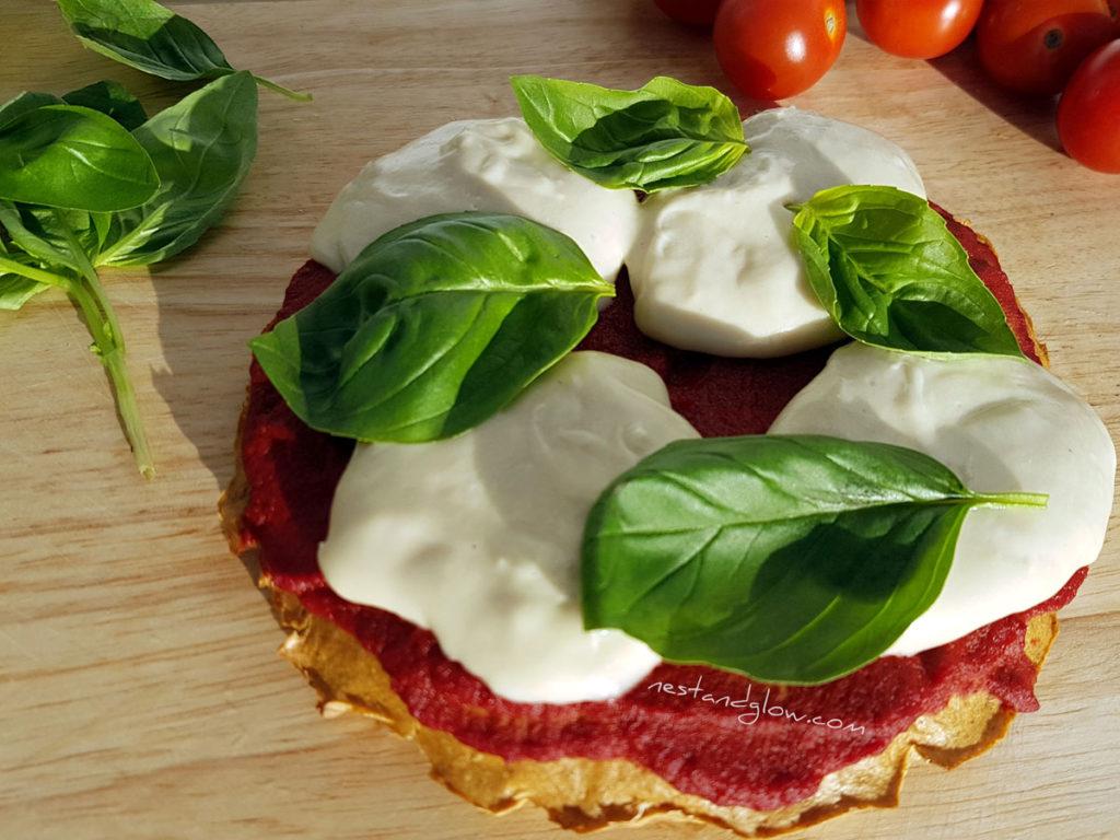 cashew mozzarella quinoa crust with fresh tomatoes and basil