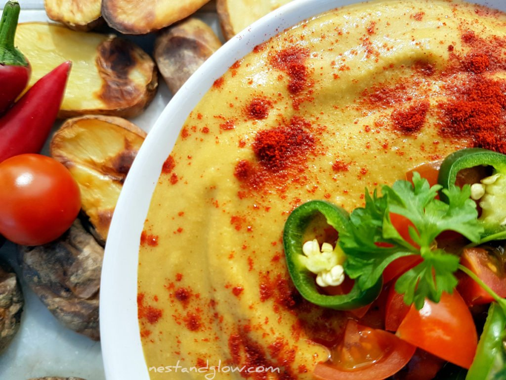 Light vegan Queso Cheese Dip topped with paprika, chilli and tomatoes