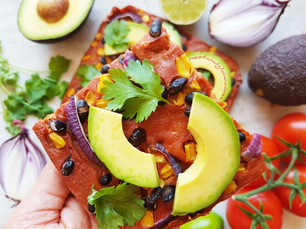 A slice of Mexican Quinoa Flatbread with avocado