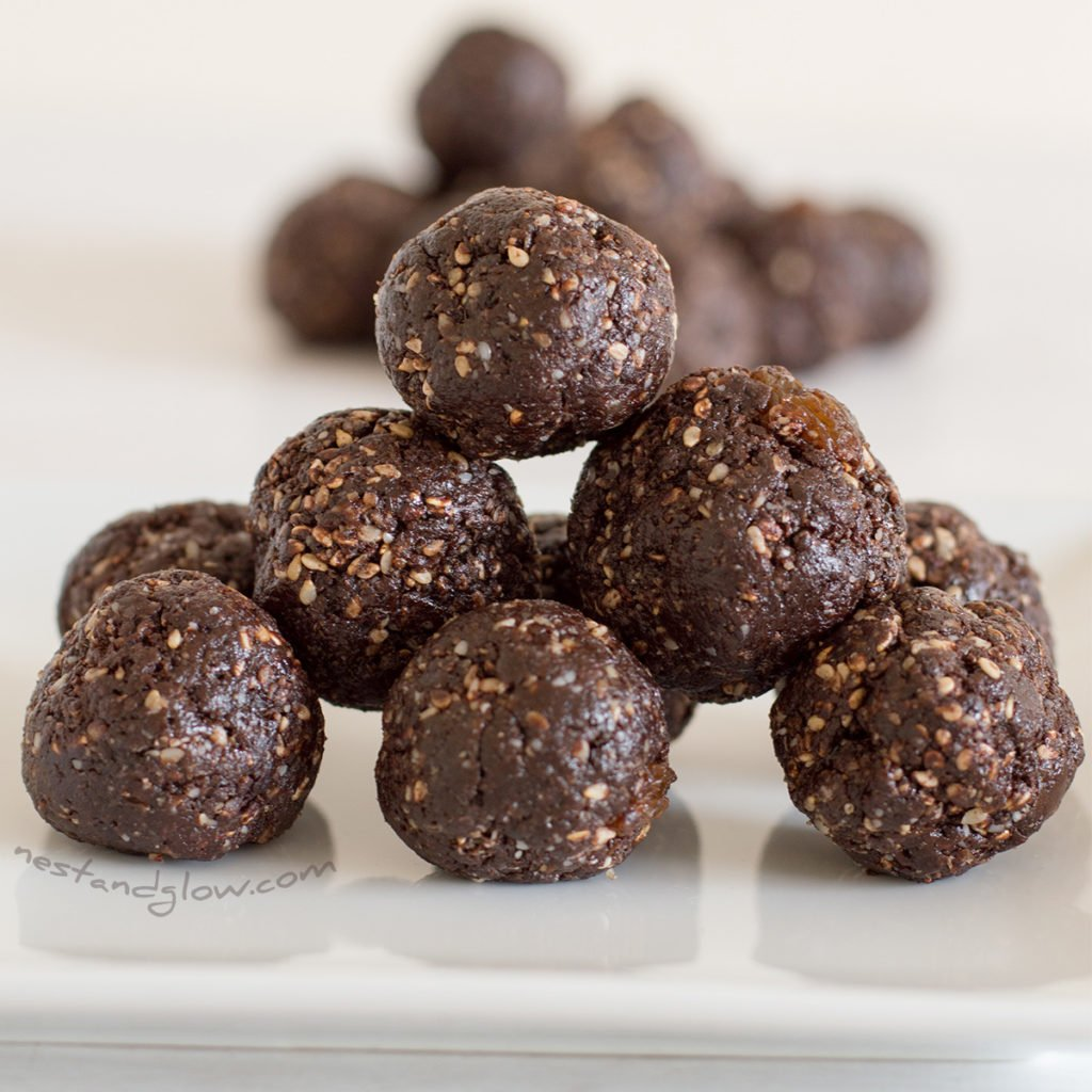 a stack of raw chocolate halva sesame truffles