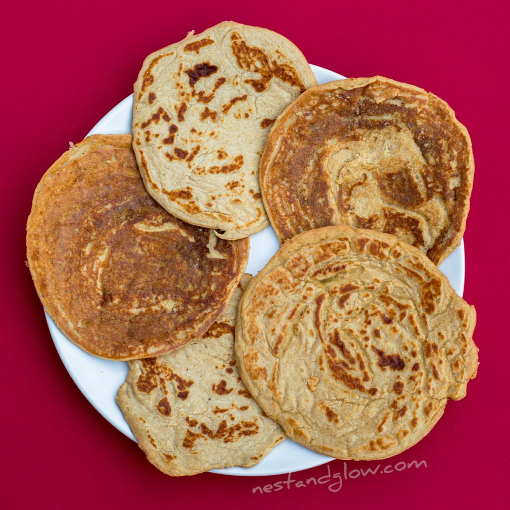 easy vegan healthy lentil pancakes on a plate. these protein pancakes look abit like naan bread and people have been known to use them for a main as they're wheat free and only slightly sweet.