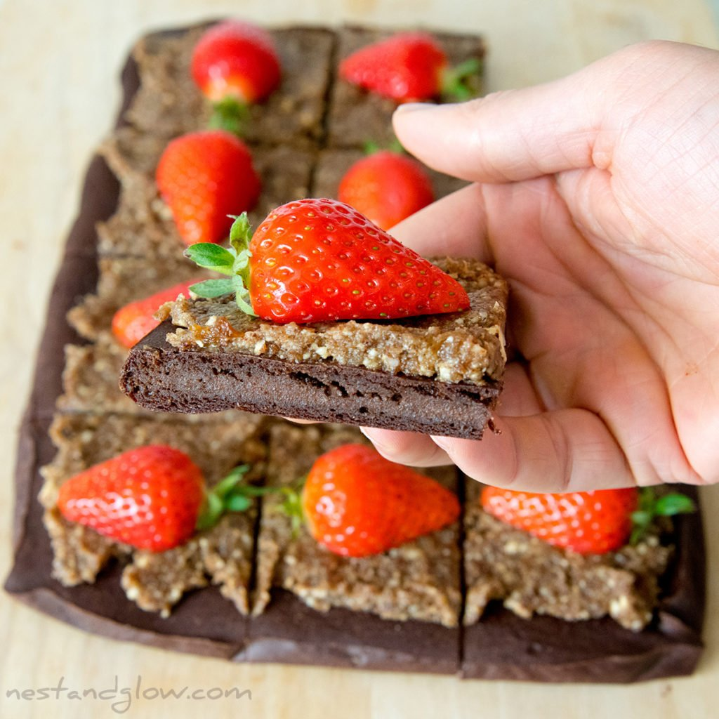 quinoa chocolate brownie easy and healthy gluten free recipe. suitable for vegan and wheat free diets and topped with a strawberry