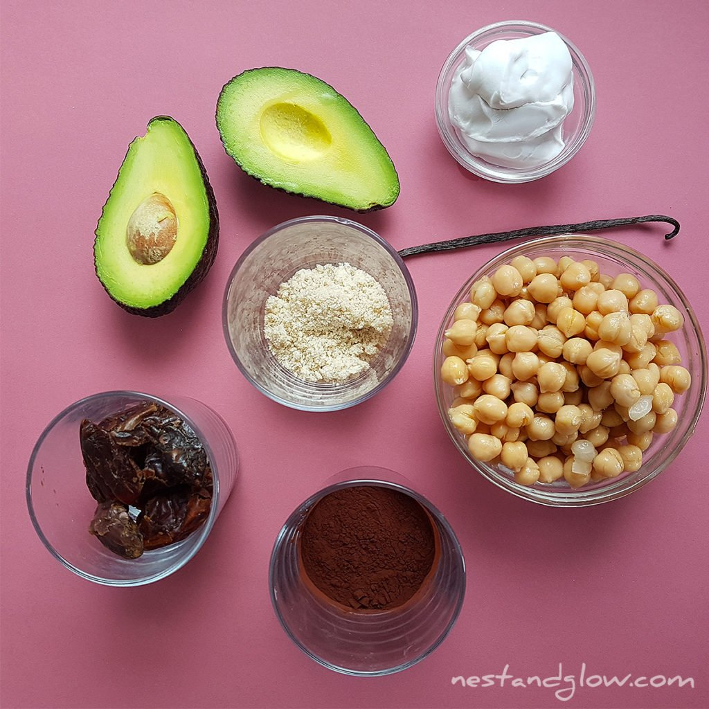 chocolate avocado hummus ingredients are chickpeas, sesame seeds, vanilla, avocado, coconut cream, dates and cocoa