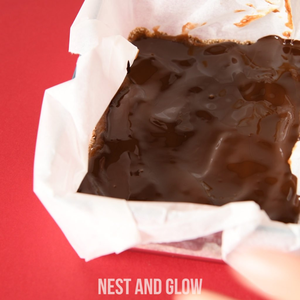 melted chocolate on top of a healthy caramel date shortbread