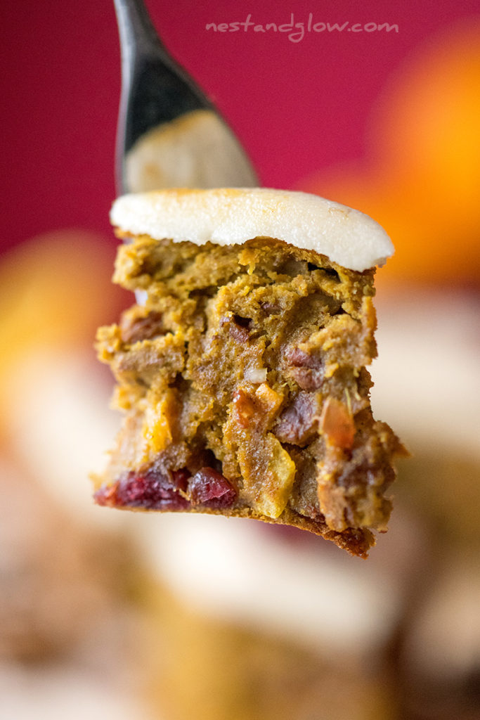 iced healthy fruit cake on a fork. this christmas cake is made from fruit, nuts and quinoa
